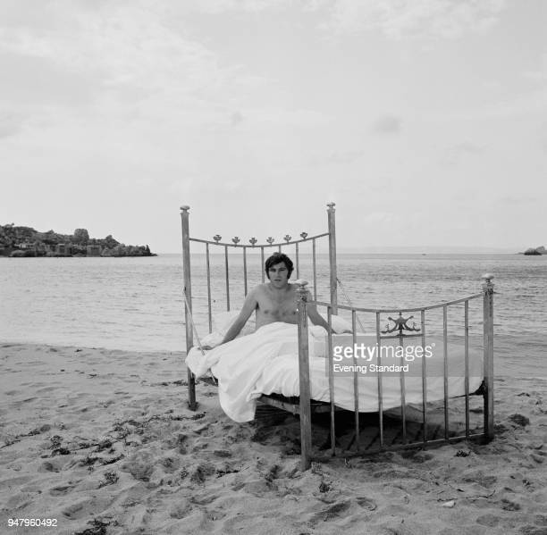 English actor and singersongwriter Anthony Newley lying in bed on a beach UK 13th June 1968