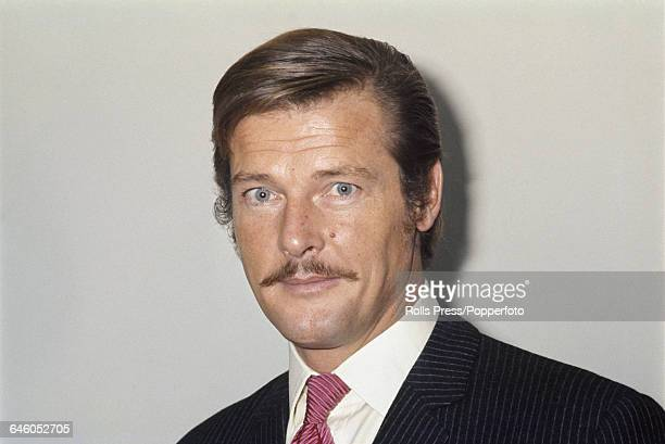 English actor and star of the television series 'The Saint' Roger Moore pictured wearing a moustache for the film 'The Man Who Haunted Himself' in...