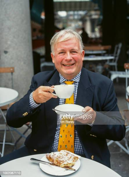 English actor and television presenter Christopher Biggins drinking a cappuccino UK 2000s
