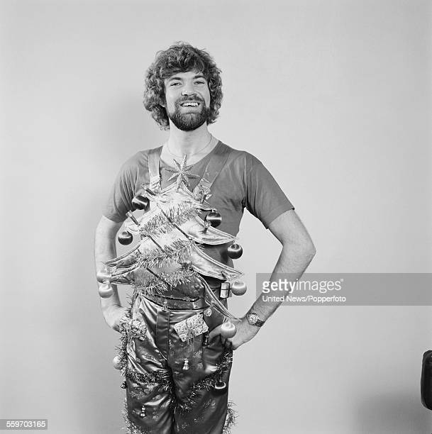 English actor and television presenter, Matthew Kelly pictured wearing a pair of christmas tree themed dungarees with baubles in London on 1st...
