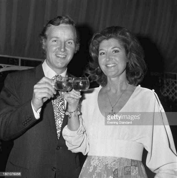 English actor and television presenter Nicholas Parsons with his wife, actress Denise Bryer, UK, June 1973.