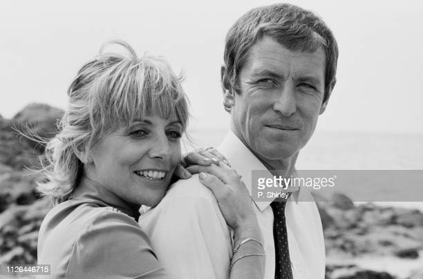 English actor and writer John Nettles and English actress Deborah Grant on the set of television series 'Bergerac', UK, 10th September 1983.