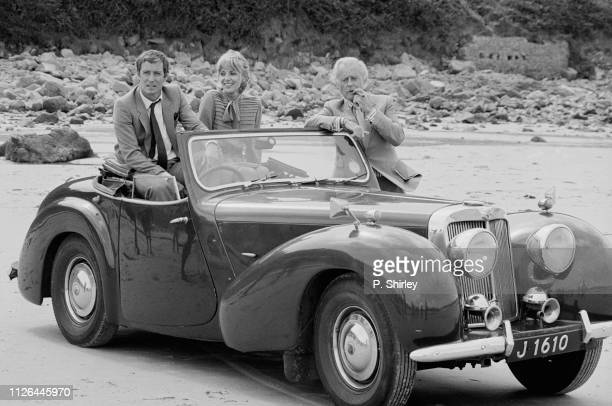 English actor and writer John Nettles, English actress Deborah Grant, English actor Terence Alexander on the set of television series 'Bergerac', UK,...