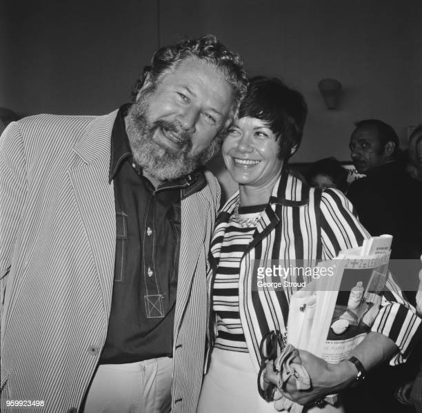 English actor and writer Peter Ustinov pictured with his wife Helene du Lau d'Allemans at Heathrow airport in London on 10th July 1972