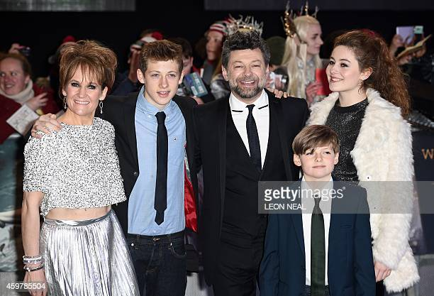 English actor Andy Serkis poses for pictures on the red carpet with his wife Lorraine Ashbourne and their children Ruby Sonny and Louis upon arrival...