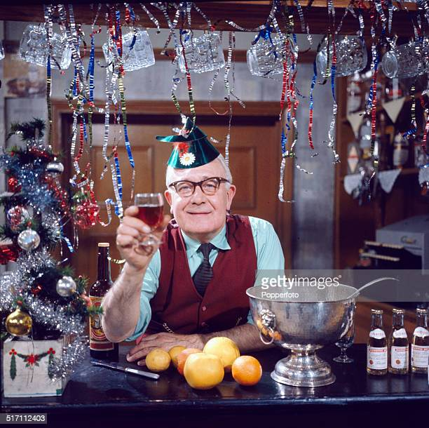 English actor Arthur Leslie posed in character as landlord Jack Walker behind the bar of the Rovers Return Inn in the long running television soap...