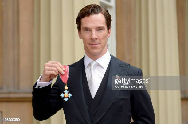 English actor Benedict Cumberbatch poses after receiving the Commander of the Order of the British Empire for services to the performing arts and to...
