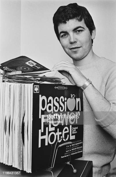 English actor Bill Kenwright browses through a collection of single records and long playing albums in April 1968. Bill Kenwright currently plays the...