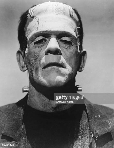 English actor Boris Karloff in full makeup for his role as The Monster in James Whale's horror films 'Frankenstein' and 'Bride of Frankenstein' circa...