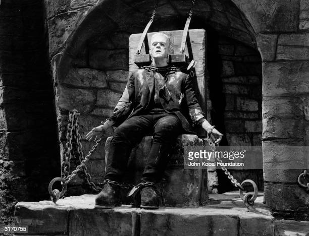 English actor Boris Karloff is captured and chained up in a scene from 'Bride of Frankenstein' directed by James Whale