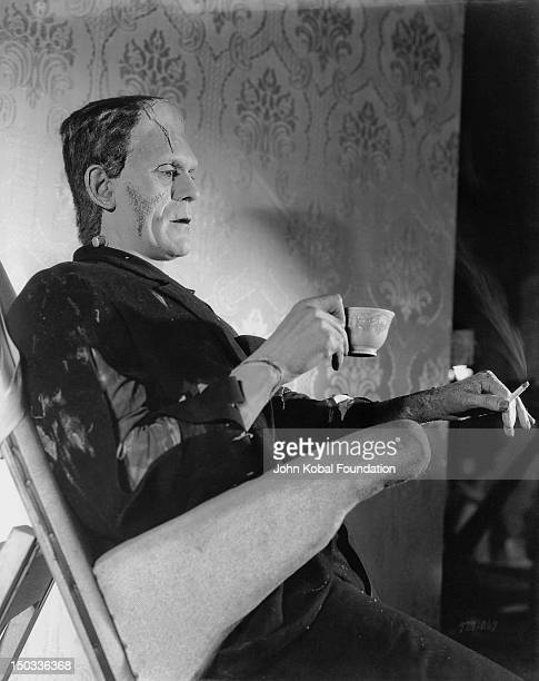 English actor Boris Karloff relaxes on the set of the film 'Bride of Frankenstein' in which he reprises his role as Frankenstein's creation 1935