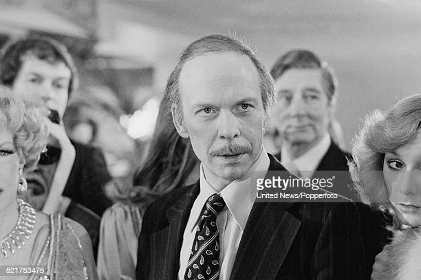 English actor Brian Murphy pictured in character as George Roper on the set of the film version of the television series 'George and Mildred' in...