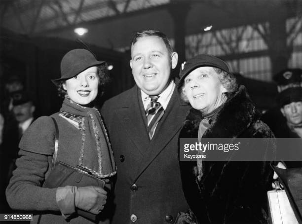 English actor Charles Laughton arrives at Waterloo Station in London with his wife actress Elsa Lanchester and his mother Eliza 13th December 1932