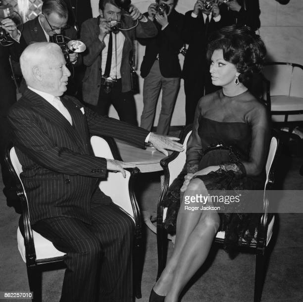 English actor Charlie Chaplin with Italian actress Sophia Loren at a press reception at the Savoy Hotel in London before starting work on the film 'A...