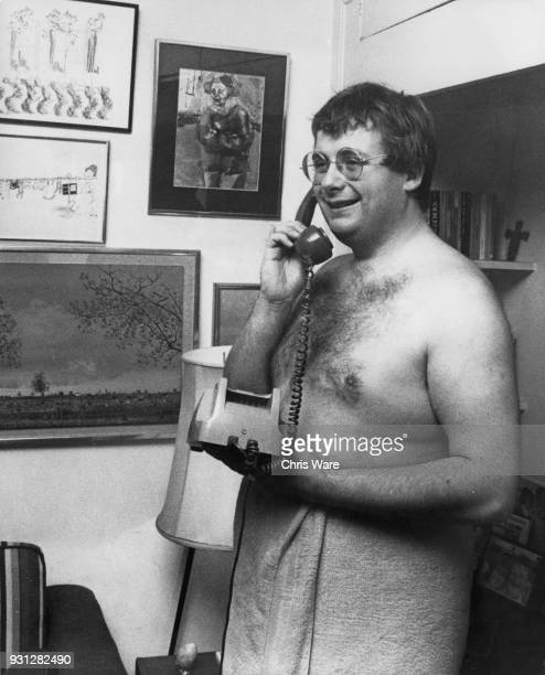 English actor Christopher Biggins takes a telephone call in his flat above the Phoenix Theatre in London 1978