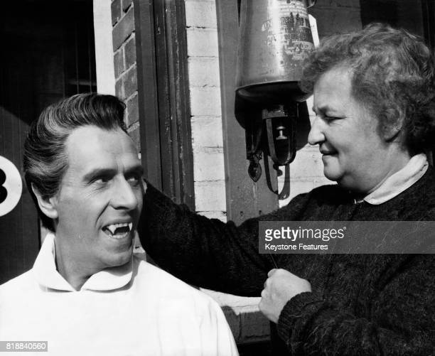 English actor Christopher Lee has his hair done by stylist Freda Steiger at Bray Studios in Berkshire home of Hammer Film Productions circa 1970