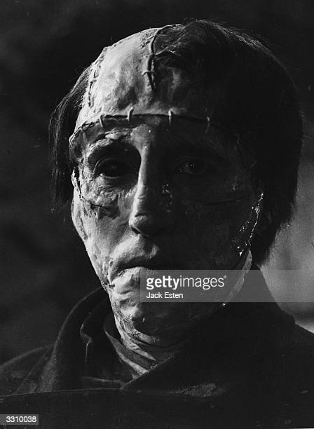 English actor Christopher Lee plays the monster in a scene from the Hammer horror film 'The Curse of Frankenstein' directed by Terence Fisher...