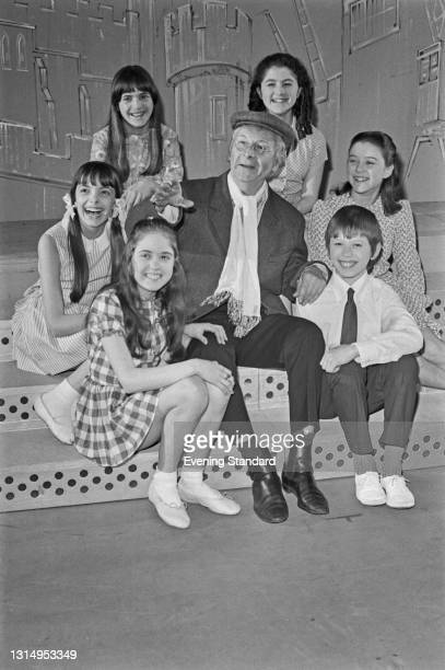 English actor Clive Dunn with a group of children, UK, 1st May 1971. He had a number 1 hit in the UK that month with his single 'Grandad', which...