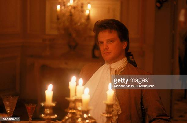 English actor Colin Firth sits in candlelight on the Paris set of the film Valmont directed by Czech director Milos Forman The film is set in 18th...
