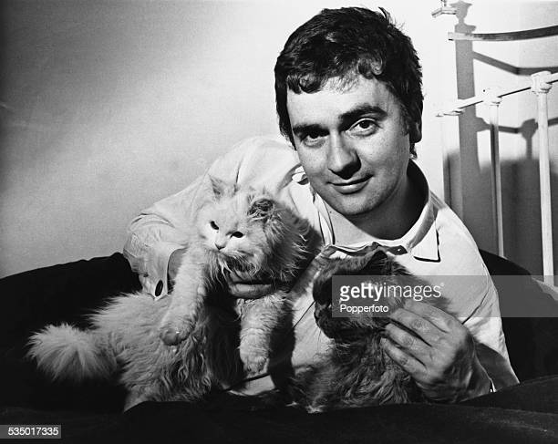 English actor comedian and musician Dudley Moore with two cats 1966