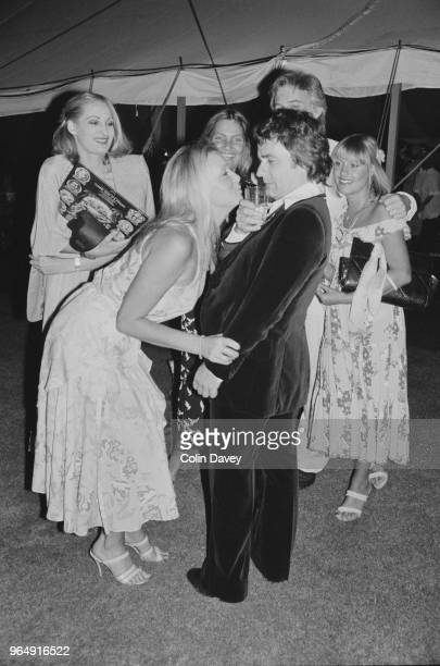 English actor comedian musician and composer Dudley Moore attending a party with British television hostess Anthea Redfern and some friends UK 17th...