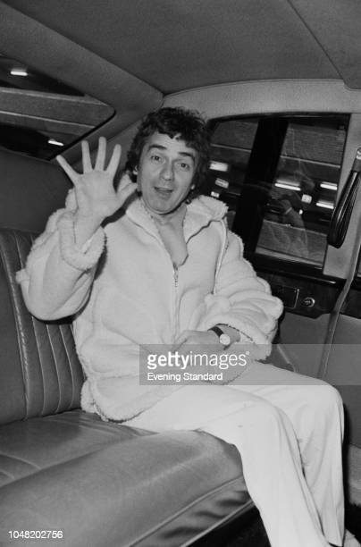English actor comedian musician and composer Dudley Moore waving from the backseat of a car UK 21st January 1980