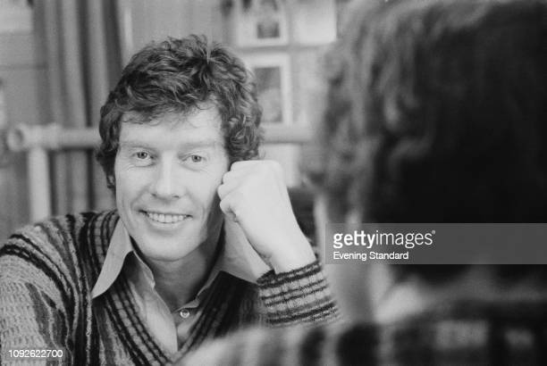 English actor, comedian, singer, voice artist and philanthropist Michael Crawford seen reflected on a mirror, UK, 25th April 1975.
