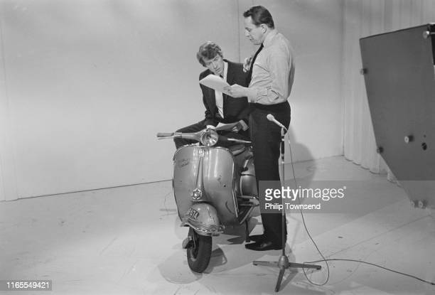 English actor comedian singer voice artist Michael Crawford rehearsing on Vespa on the set of BBCTV satire programme 'Not So Much a Programme More a...