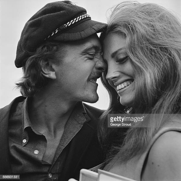 English actor David Hemmings with his girlfriend American actress Gayle Hunnicutt at London Airport 28th July 1967