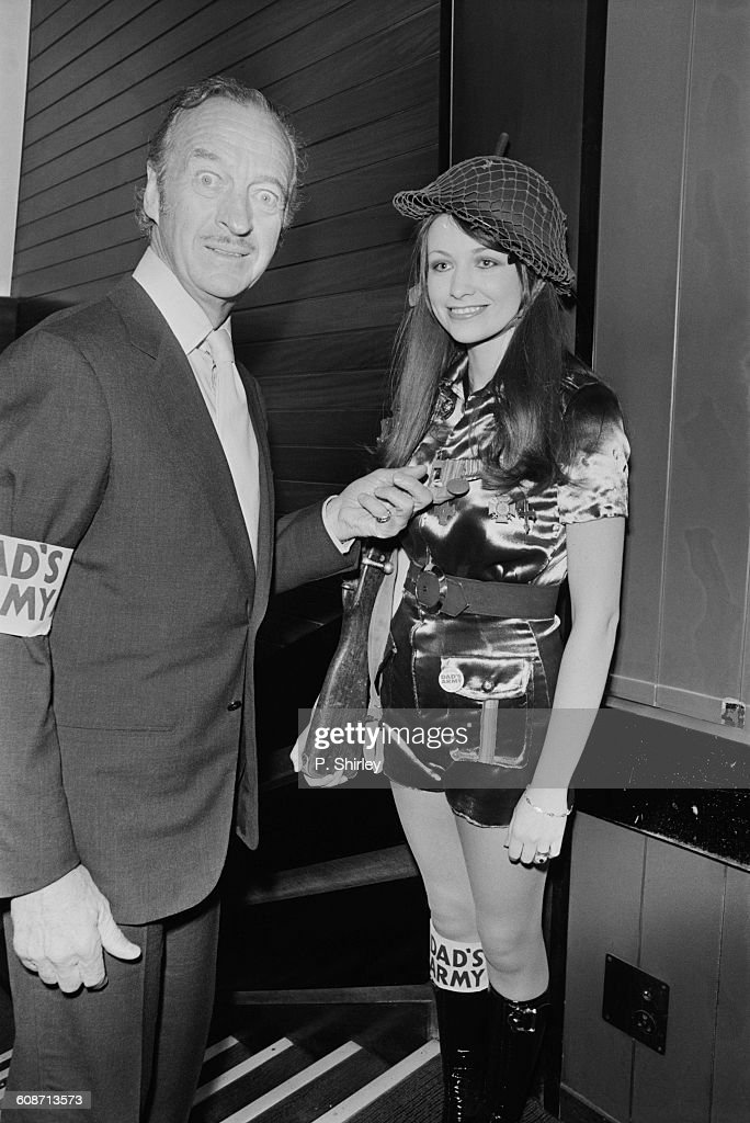 English actor David Niven (1910 - 1983) and actress Joanna Scott at the premiere of 'Dad's Army', London, UK, 14th March 1971.