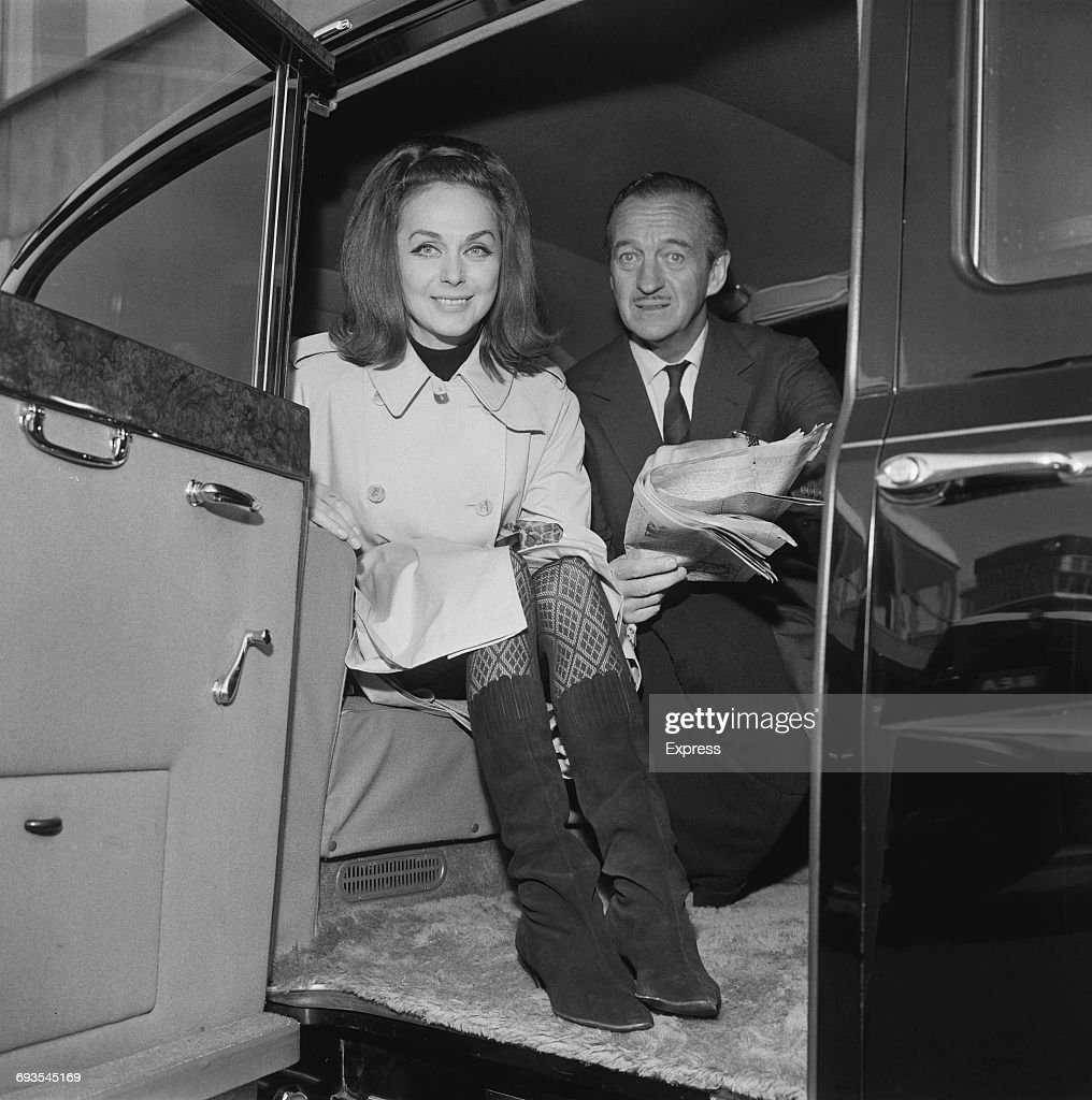 English actor David Niven (1910 - 1983) and his wife Hjördis at London Airport, 28th March 1965.