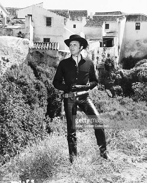 English actor Dirk Bogarde as Anacleto Komachi in the film 'The Singer Not the Song' during filming on location in Andalucia Spain 1961