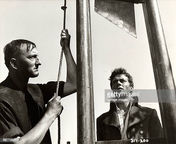 English actor Dirk Bogarde as Sydney Carton faces the guillotine in a scene from the film 'A Tale of Two Cities' 1958
