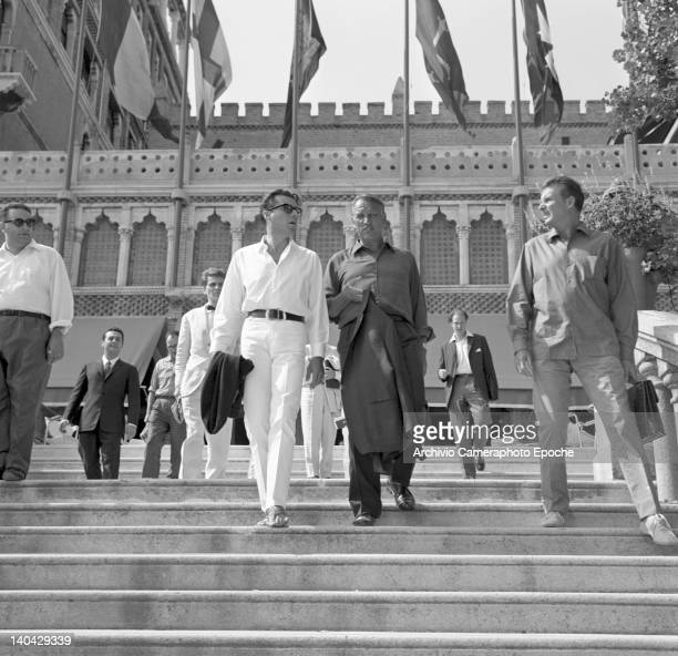 English actor Dirk Bogarde descending the Excelsior Hotel stairs with Joseph Losey Lido Venice 1960s