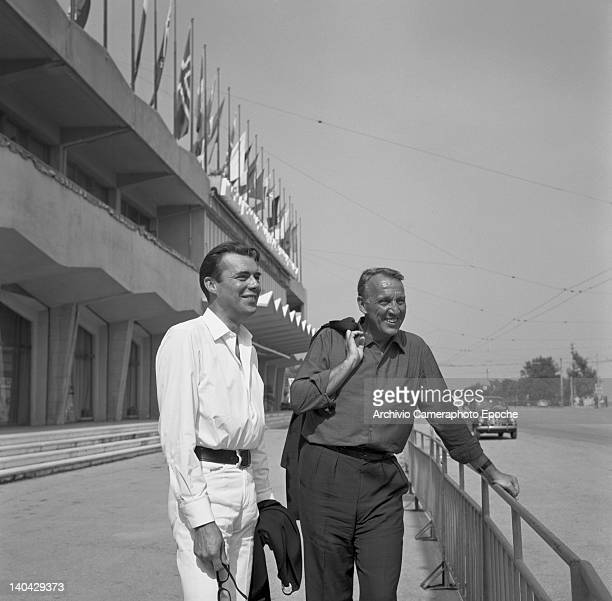 English actor Dirk Bogarde outside the Movie Palace with Joseph Losey Lido Venice 1960s