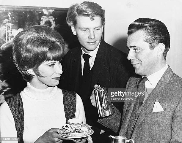English actor Dirk Bogarde presents English actor and actress James Fox and Wendy Craig at a reception for his new film London 1963 The trio will...