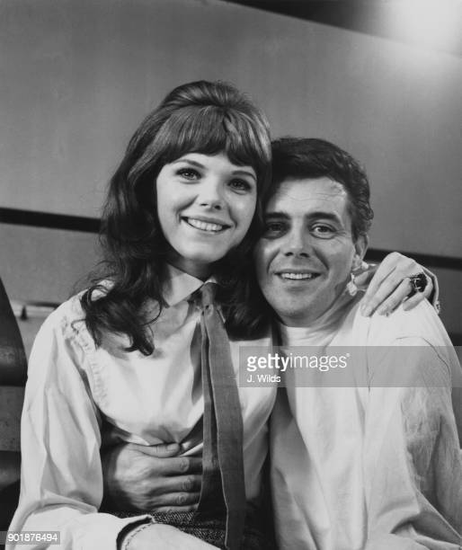 English actor Dirk Bogarde with actress Samantha Eggar his costar in the film 'Doctor in Distress' being filmed at Pinewood Studios England 2nd April...