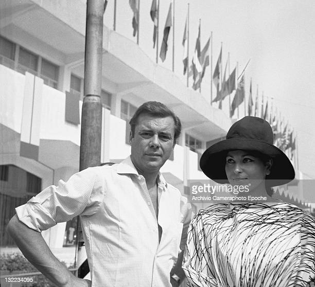 English actor Dirk Bogarde with Israeli actress Haya Harareet outside the Movie Festival palace Lido Venice 1967