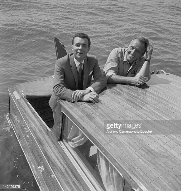 English actor Dirk Bogarde with Joseph Losey on a water taxi Lido Venice 1960s
