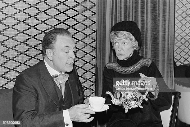 English actor Donald Sinden and American actress and singer Elaine Stritch take tea together during filming of the television series Two's Company in...
