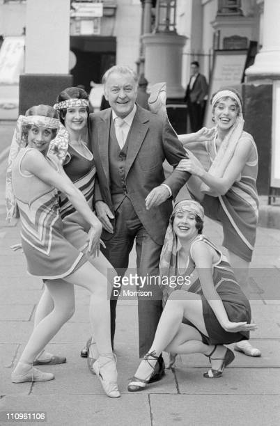English actor Donald Sinden and cast members from the musical '42nd Street' outside the Theatre Royal Drury Lane 9th November 1984