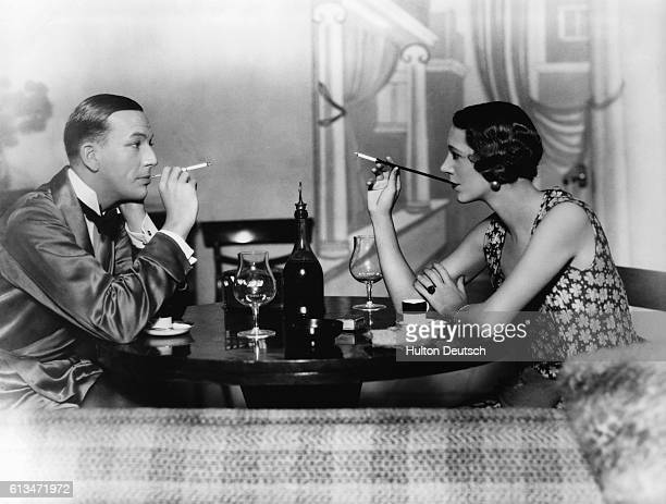English actor, dramatist and composer Noel Coward appearing with English actress Gertrude Lawrence in Private Lives, London, 1930. Private Lives was...