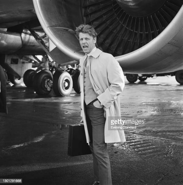 English actor Edward Fox at Heathrow Airport in London, UK, 14th May 1973. He starred in the 1973 film 'The Day of the Jackal'.