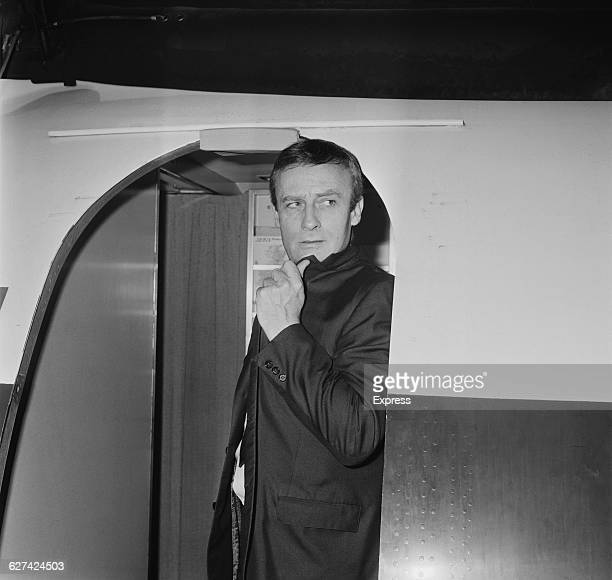 English actor Edward Woodward in the doorway of a BEA airliner at London Airport , 3rd April 1971. .