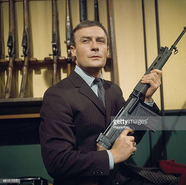 English actor Edward Woodward pictured holding a rifle in a scene from the television spy drama series 'Callan - Red Knight, White Knight' in 1968.