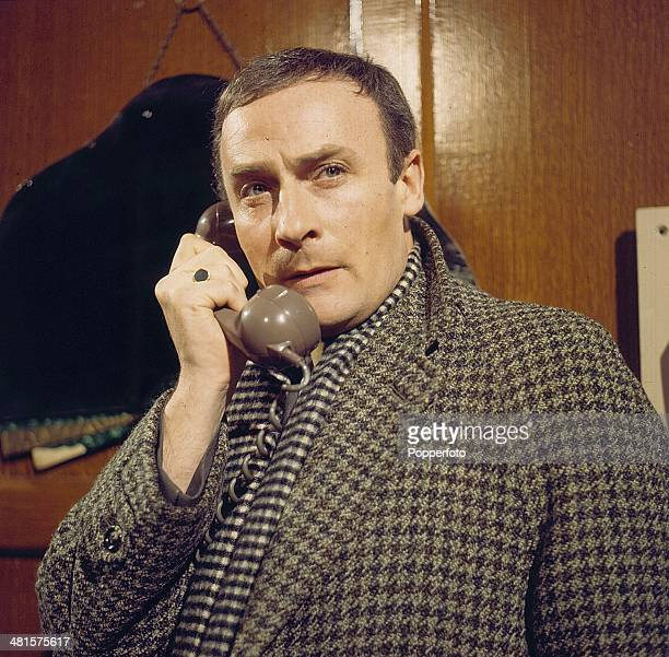 English actor Edward Woodward pictured holding a telephone in a scene from the television spy drama series 'Callan - The Little Bits & Pieces Of...