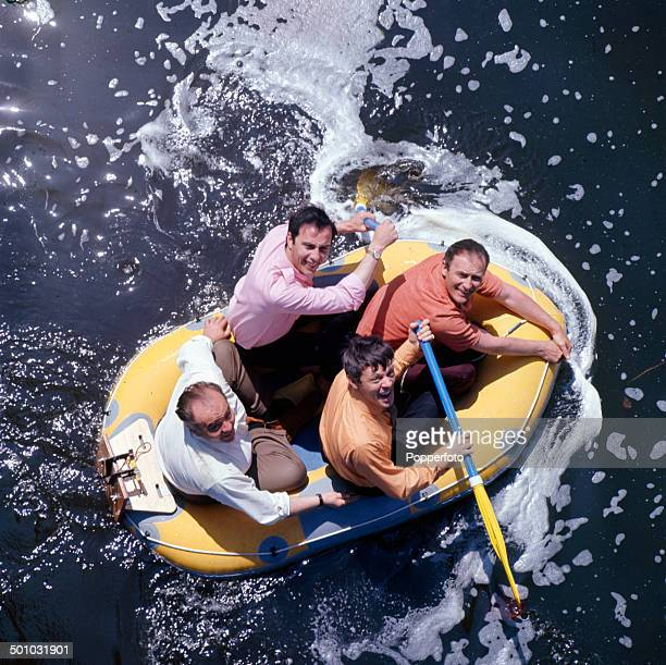 English actor Edward Woodward pictured top right in a dingy with fellow actors and cast members of the television drama series 'Callan', Anthony...