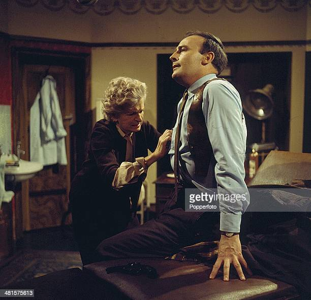English actor Edward Woodward pictured with actress Gladys Cooper in a scene from the television spy drama series 'Callan - The Little Bits & Pieces...