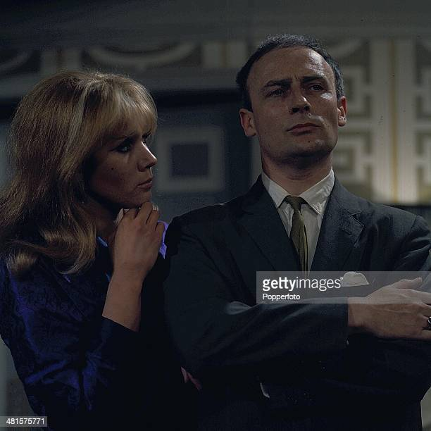 English actor Edward Woodward pictured with actress Linda Marlowe in a scene from the television spy drama series 'Callan - The Good Ones Are all...
