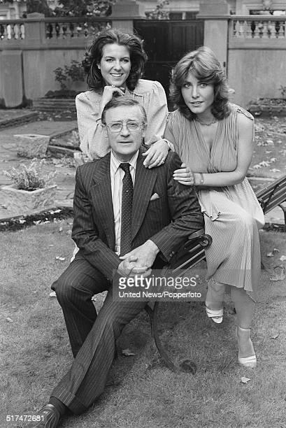 English actor Edward Woodward pictured with actresses Hilary Tindall and Amanda Kemp who all appear in the television comedy series Nice Work posed...